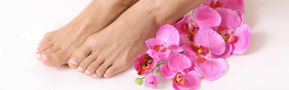 pedicured feet and flowers